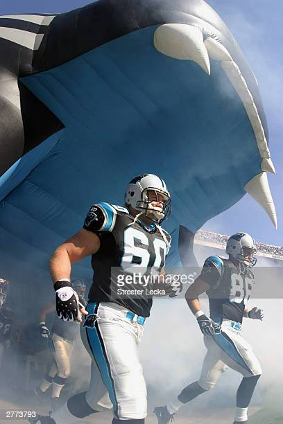 Center Jeff Mitchell and teammate wide receiver Karl Hankton of the Carolina Panthers run out of the tunnel before the game against the Tampa Bay...