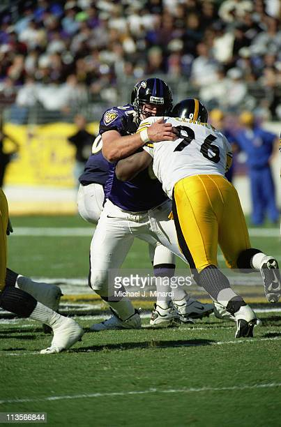 Center Jeff Mitchell of the Baltimore Ravens takes on Tackle Kendrick Clancy of the Pittsburgh Steelers at the line of scrimmage during a NFL game at...