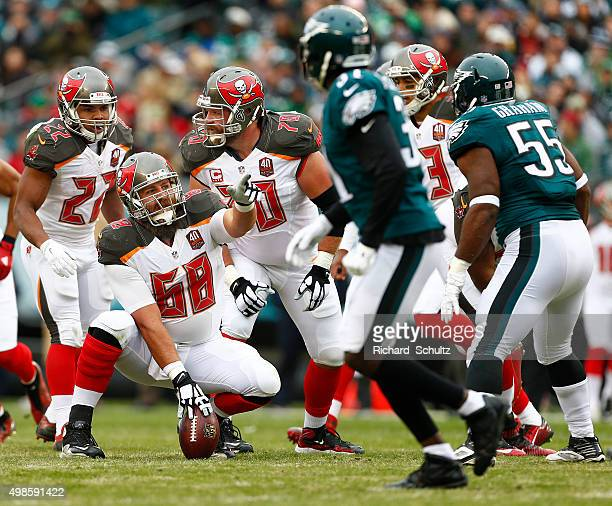 Center Joe Hawley, Doug Martin and Logan Mankins of the Tampa Bay Buccaneers set a formation during the first quarter of a game against the...