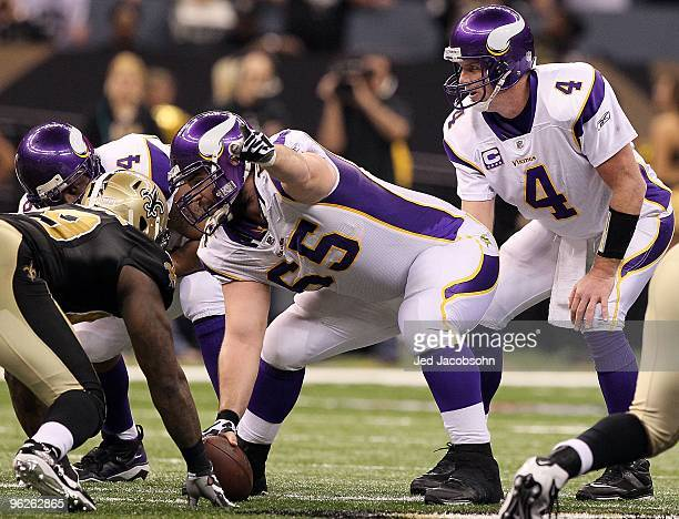 Center John Sullivan of the Minnesota Vikings gestures as Brett Favre calls the snap count at the line of scrimmage against the New Orleans Saints...