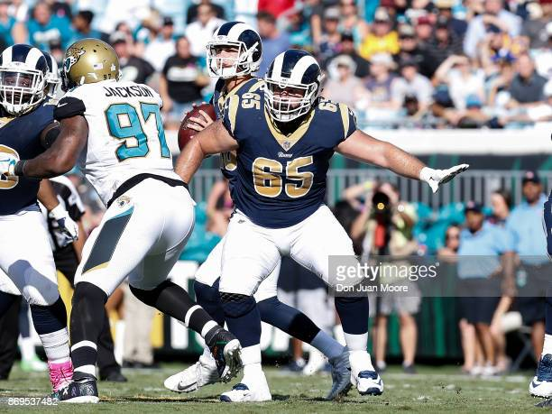 Center John Sullivan protects Quarterback Jared Goff of the Los Angeles Rams on a pass play during the game against the Jacksonville Jaguars at...