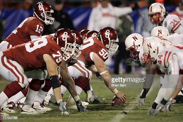 Center Jon Cooper of the Oklahoma Sooners prepares to snap the ball to quarterback Paul Thompson against the Nebraska Cornhuskers during the 2006 Dr...
