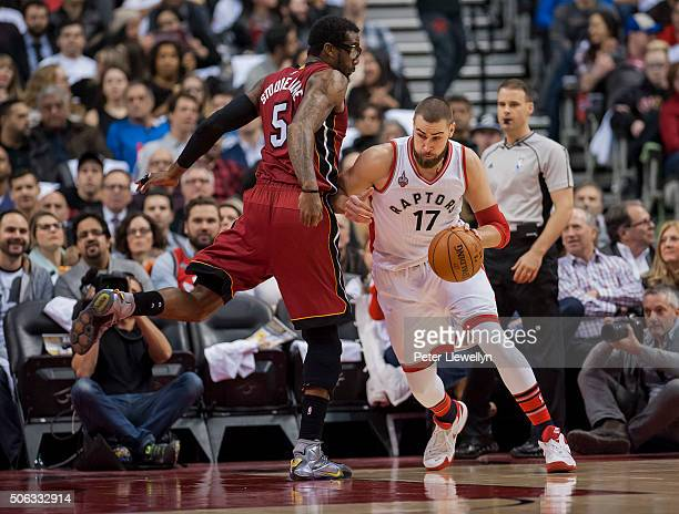 Center Jonas Valanciunas of the Toronto Raptors handles the ball against forward Amar'e Stoudemire of the Miami Heat in the first quarter at Air...