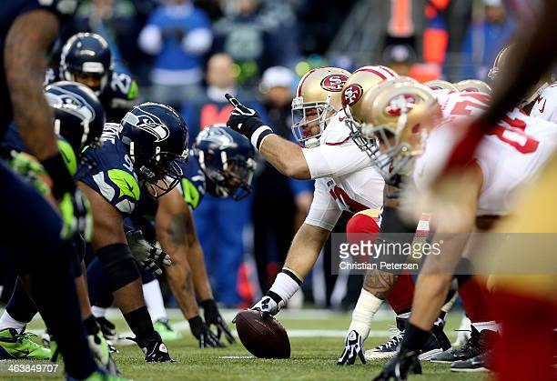 Center Jonathan Goodwin of the San Francisco 49ers calls a play against the Seattle Seahawks during the 2014 NFC Championship at CenturyLink Field on...