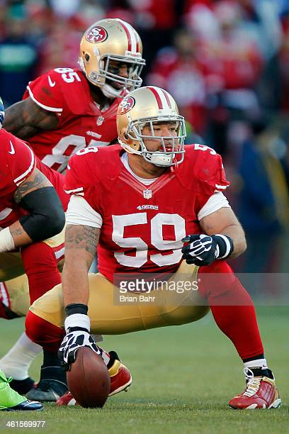 Center Jonathan Goodwin of the San Francisco 49ers looks around as tight end Vernon Davis goes in motion against the Seattle Seahawks in the third...