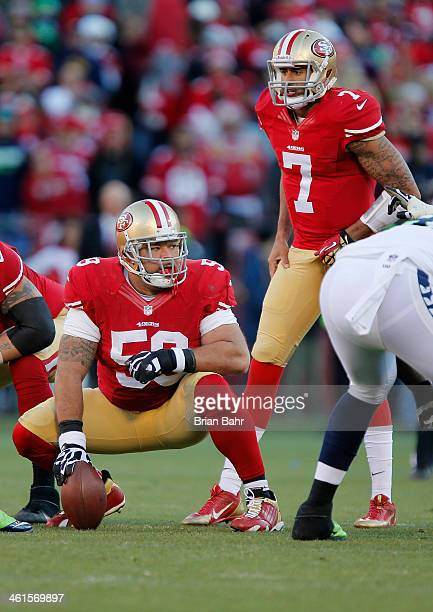 Center Jonathan Goodwin of the San Francisco 49ers looks down the line as quarterback Colin Kaepernick calls out the snap count against the Seattle...