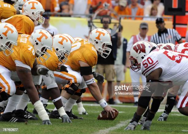Center Josh McNeil of the Tennessee Volunteers sets to block against the Wisconsin Badgers in the 2008 Outback Bowl at Raymond James Stadium on...