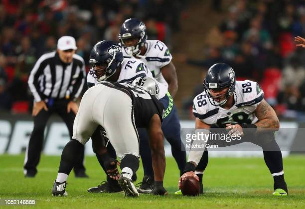 Center Justin Britt of the Seattle Seahawks lines up over the ball during NFL action against the Oakland Raiders at Wembley Stadium on October 14...