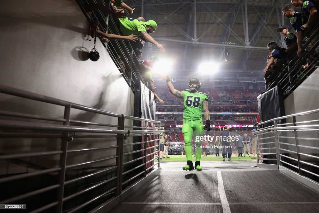 Center Justin Britt #68 of the Seattle Seahawks waves to fans as he leaves the field following the NFL game against the Arizona Cardinals at the University of Phoenix Stadium on November 9, 2017 in Glendale, Arizona. The Seahawks defeated the Cardinals 22-16.