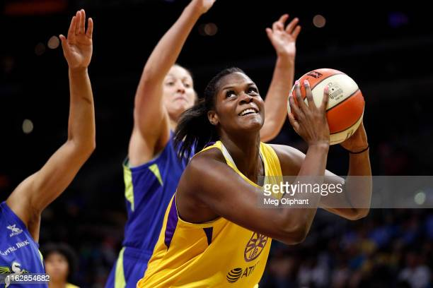 Center Kalani Brown of the Los Angeles Sparks looks to shoot against the Dallas Wings at Staples Center on July 18 2019 in Los Angeles California...