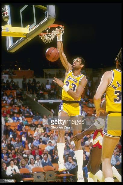 Center Kareem Abdul-Jabbar of the Los Angeles Lakers slams an easy two-pointer over the Atlanta Hawks during a game at The Forum in Inglewood,...