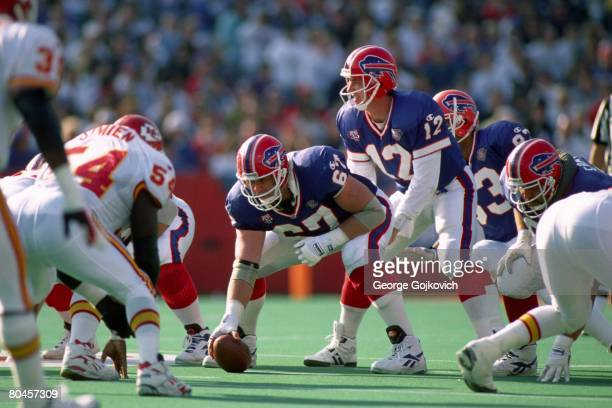 Center Kent Hull of the Buffalo Bills prepares to snap the ball to quarterback Jim Kelly during a game against the Kansas City Chiefs at Rich Stadium...