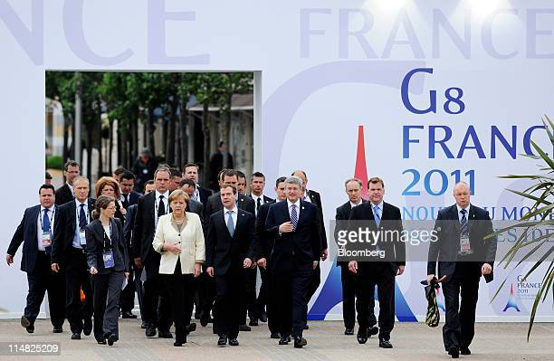 Center left to right Angela Merkel Germany's chancellor Dmitry Medvedev Russia's president and Stephen Harper Canada's prime minister arrive for a...