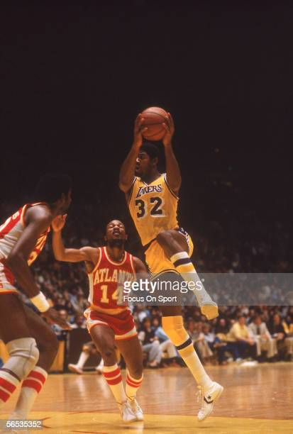 Center Magic Johnson of the Los Angeles Lakers jumps and shoots circa the 1980's during an NBA AllStar Game