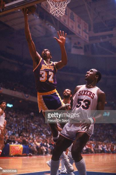 Center Magic Johnson of the Los Angeles Lakers jumps and shoots circa the 1980's during a game against the Philadelphia Sixers