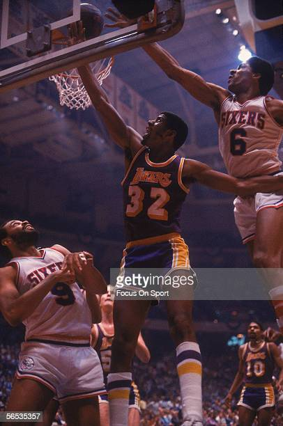 Center Magic Johnson of the Los Angeles Lakers jumps and shoots circa the 1980's during a game against the Philadelphia Sixers.