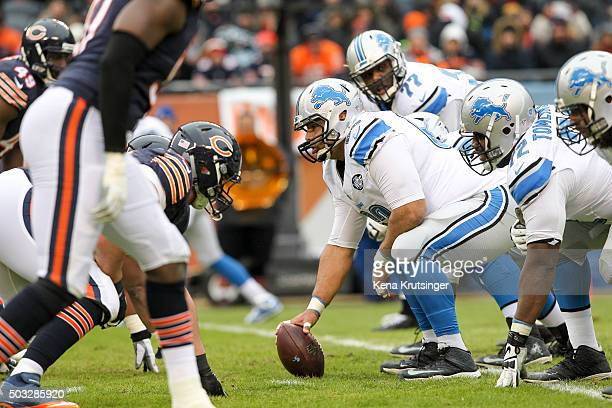 Center Manny Ramirez of the Detroit Lions holds the football for the snap in the second quarter against the Chicago Bears at Soldier Field on January...