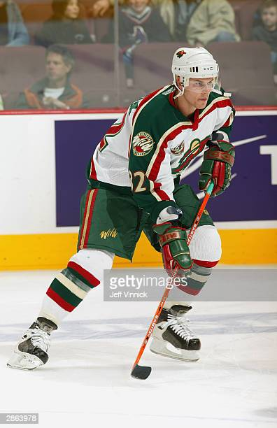 Center Marc Chouinard of the Minnesota Wild skates on the ice during the game against the Vancouver Canucks at General Motors Place on November 8...