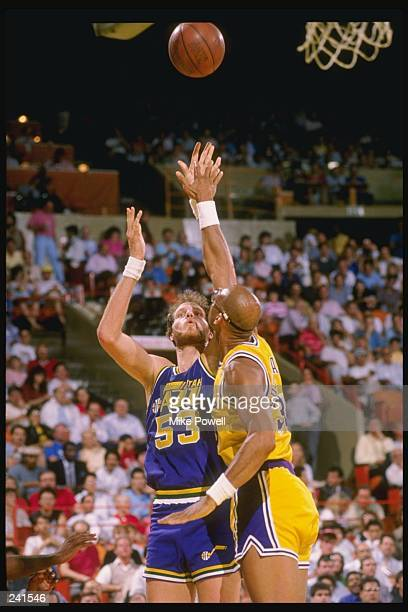 Center Mark Eaton of the Utah Jazz in action against guard Kareem AbdulJabbar of the Los Angeles Lakers during a game at the Great Western Forum in...