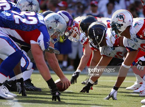 NFC center Matt Birk of the Minnesota Vikings squares off with AFC defensive tackle Jamal Williams at the line of scrimmage during the NFL Pro Bowl...