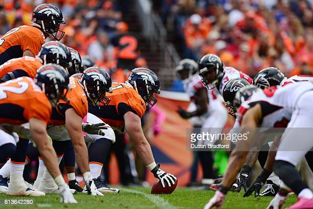 Center Matt Paradis of the Denver Broncos prepares to hike the ball during the second half of the game against the Atlanta Falcons at Sports...