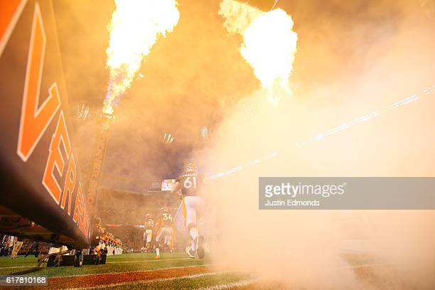 Center Matt Paradis of the Denver Broncos runs on to the field before the game against the Houston Texans at Sports Authority Field at Mile High on...