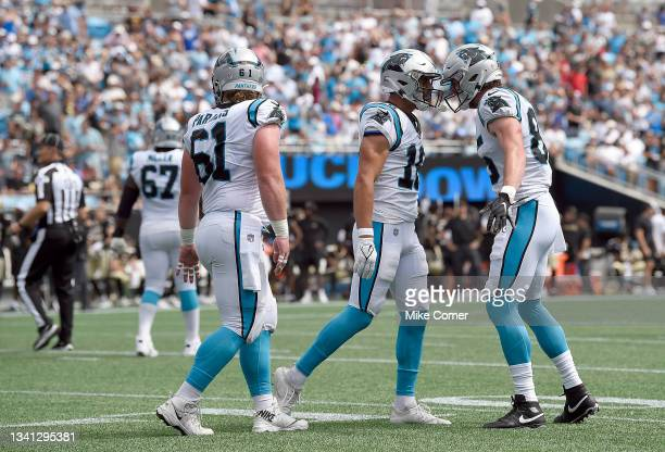 Center Matt Paradis, wide receiver Brandon Zylstra, and tight end Colin Thompson of the Carolina Panthers celebrate after a touchdown in the game...