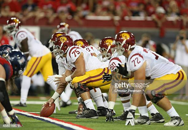 Center Max Tuerk of the USC Trojans prepares to snap the football during the college football game against the Arizona Wildcats at Arizona Stadium on...