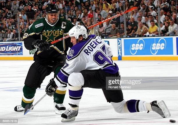Center Mike Modano of the Dallas Stars moves the puck past Jeremy Roenick of the Los Angeles Kings on October 5, 2005 at the American Airlines Center...