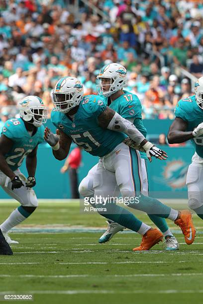 Center Mike Pouncey of the Miami Dolphins blocks against the New York Jets on November 6 2016 at Hard Rock Stadium in Miami Gardens Florida The...