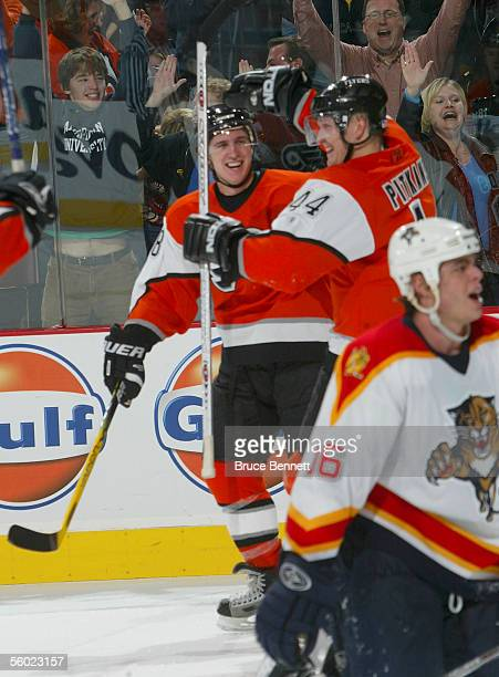 Center Mike Richards and Joni Pitkanen of the Philadelphia Flyers celebrate after Pitkanen's gamewinning goal against the Florida Panthers at 113 of...