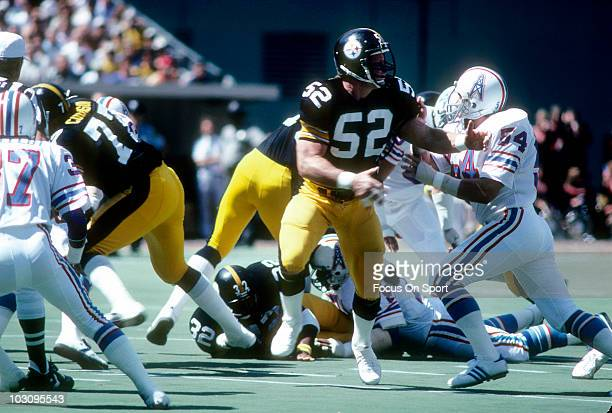 Center Mike Webster of the Pittsburgh Steelers blocks linebacker Greg Bingham of the Houston Oilers September 7 1980 during an NFL football game at...