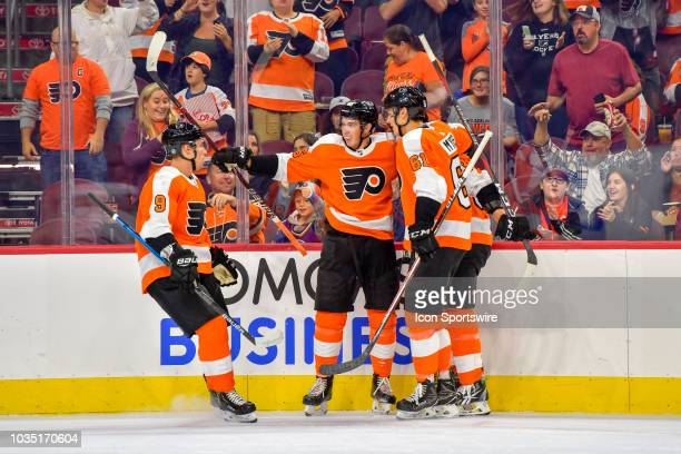 Center Mikhail Vorobyev celebrates his goal with his teammates during the NHL Preseason game between the New York Islanders and the Philadelphia...