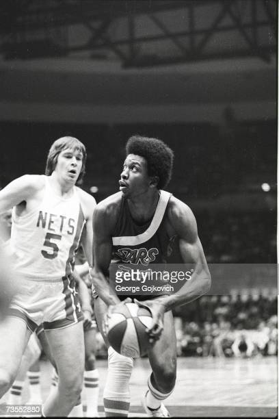 Center Moses Malone of the Utah Stars in action against center Billy Paultz of the New York Nets during an American Basketball Association game at...