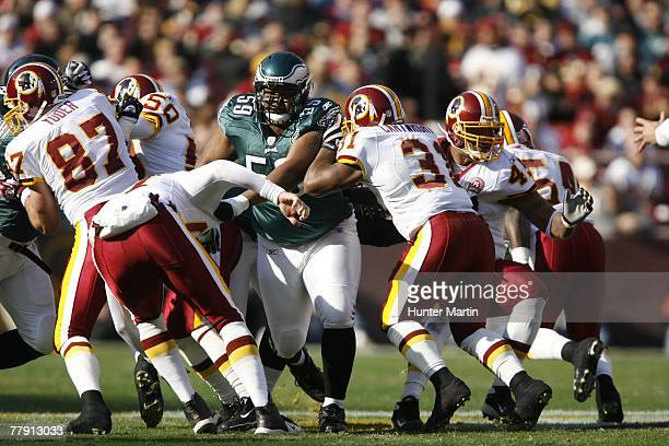 Center Nick Cole of the Philadelphia Eagles rushes the punter during a game against the Washington Redskins on November 11 2007 at Fed Ex Field in...