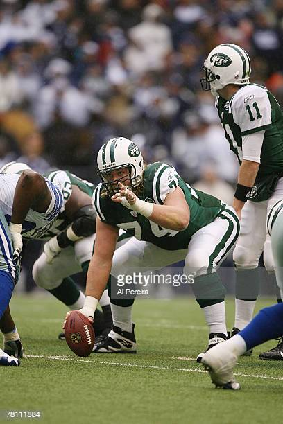Center Nick Mangold of the New York Jets gets set to snap against the Dallas Cowboys at the Thanksgiving Game between the New York Jets and the...