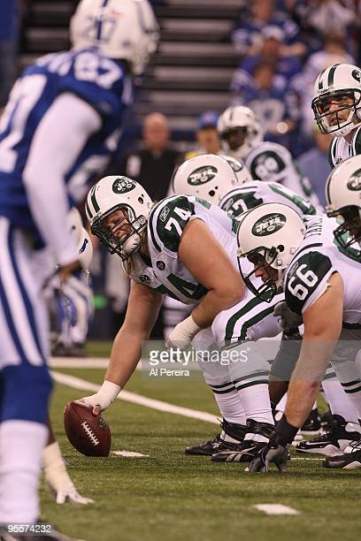Center Nick Mangold of the New York Jetscalls a play against the Indianapolis Colts at Lucas Oil Stadium on December 27 2009 in Indianapolis Indiana...