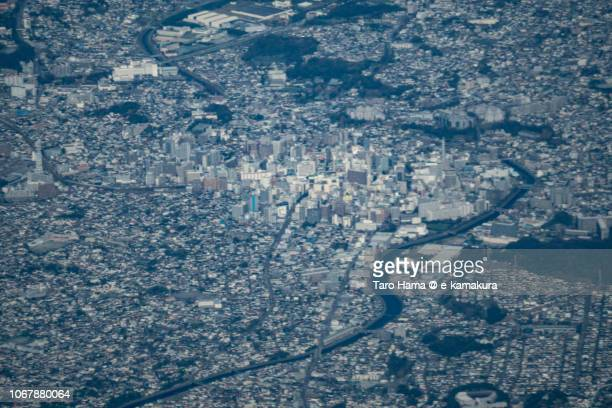Center of Fujisawa city in Kanagawa prefecture in Japan daytime aerial view from airplane
