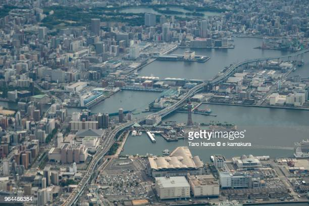 Center of Hakata-ku in Fukuoka city and Hakata Port in Japan daytime aerial view from airplane