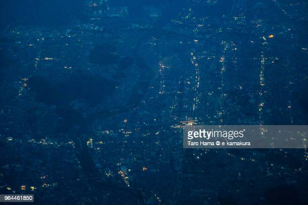 Center of Himeji city in Japan night time aerial view from airplane
