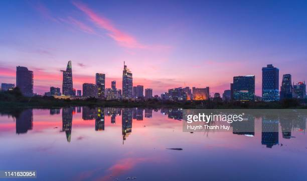 center of ho chi minh city by sunset reflection - ho chi minh city stock pictures, royalty-free photos & images