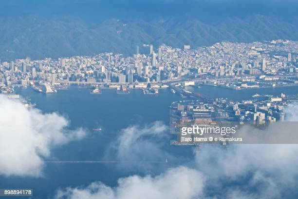 Center of Kobe city and Rokko mountain in Hyogo prefecture in Japan daytime aerial view from airplane