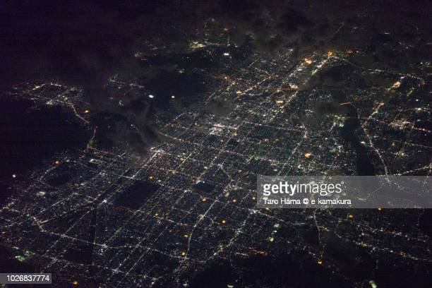 Center of Kyoto city in Japan night time aerial view from airplane