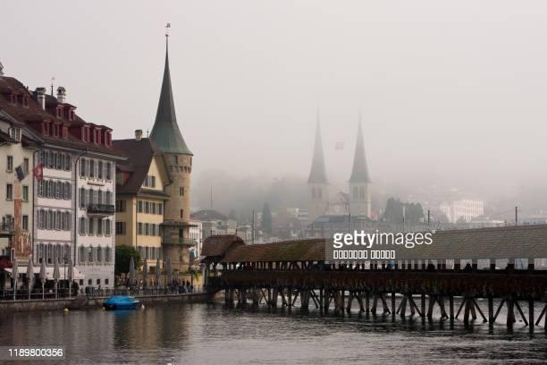 center of lucerne in the fog, canton of lucerne, switzerland - ルツェルン ストックフォトと画像