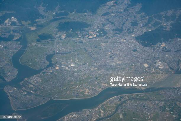 Center of Matsuzaka city in Mie prefecture in Japan daytime aerial view from airplane