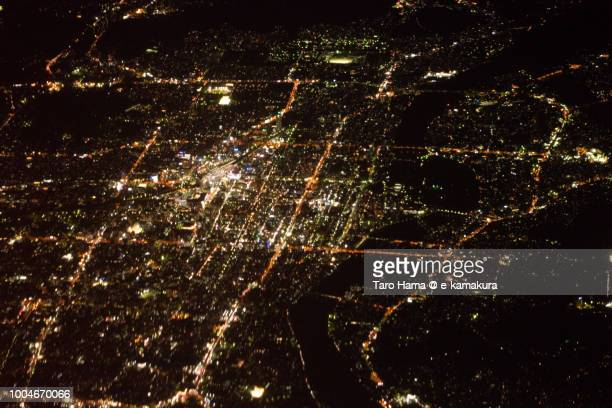 Center of Okayama city in Japan night time aerial view from airplane