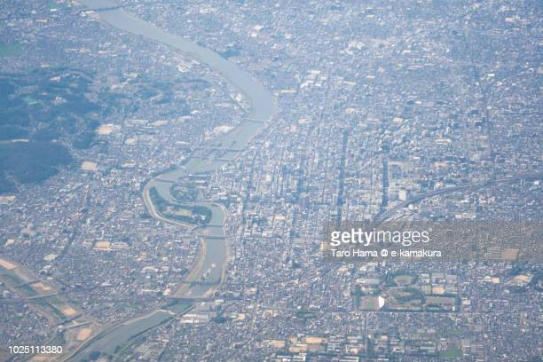 Center of Okayama city in Okayama prefecture in Japan daytime aerial view from airplane