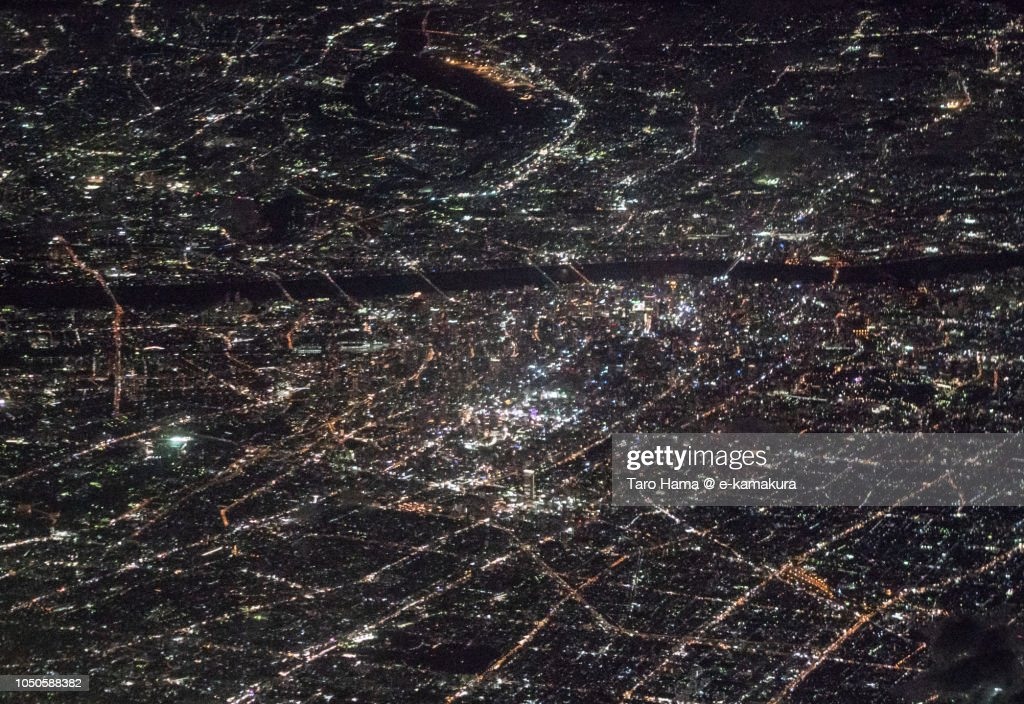 Center of Osaka city in Japan night time aerial view from airplane : ストックフォト