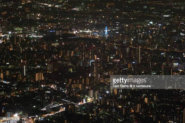 center of osaka city in japan night time aerial view from airplane - 通天閣 ストックフォトと画像