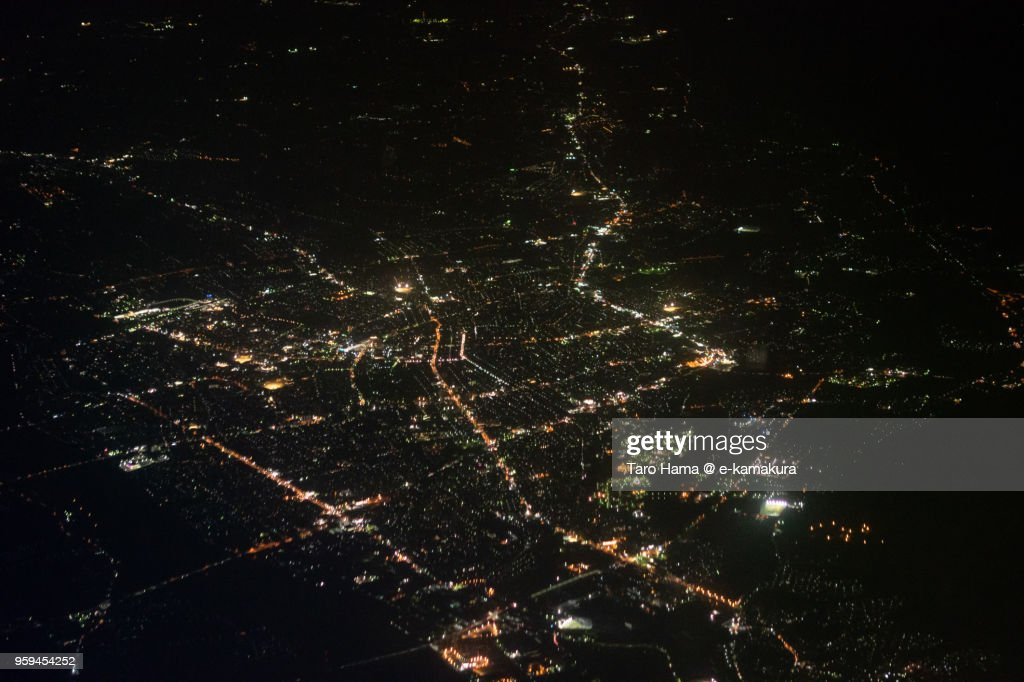 Center of Takaoka city in Toyama prefecture in Japan night time aerial view from airplane : ストックフォト